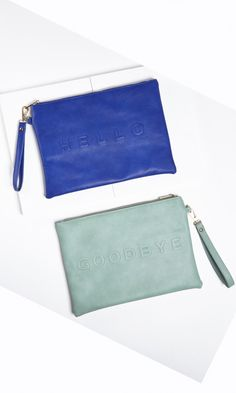 "Clutch pouch with ""hello"" and ""goodbye"" printed on the front and back."