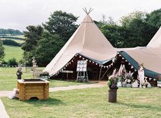 TiPi Marquee on parents farm - Image by Ann-Kathrin Koch Photography - Lace Lusan Mandongus and Belle & Bunty bridal gowns for a welsh speaking rustic wedding in Snowdonia Wales by Ann-Kathrin Koch photography