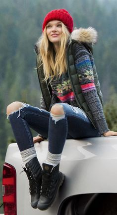 Winter sweater, beanie and jeans.
