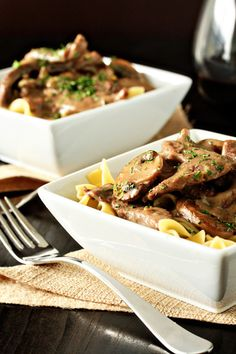 Beef Stroganoff - Tender strips of beef and mushrooms marry with red wine for and sour cream to create an incredibly hearty and delicious meal. Serve this beef stroganoff over cooked egg noodles or a bed of whipped mashed potatoes for a perfect meal worthy of any occasion.