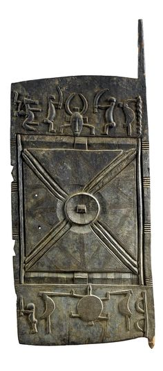 Africa | Door from the Senufo people of the Ivory Coast | Wood; with designs inspired by ceremonial life (Kpelie masks and the hunter figure)