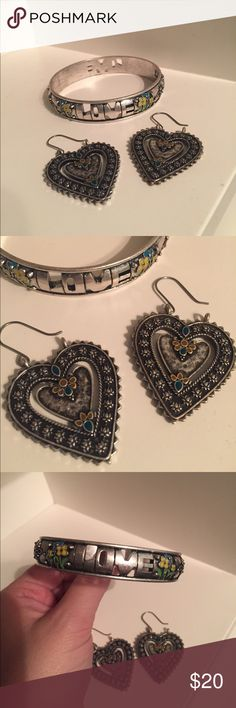 Lucky Brand Bracelet and Earrings Set Super cute Lucky Brand Bracelet and Earrings! The bracelet says love around it and has flowers and other ornate designs. The earrings are silver hearts with a pop of color to match the Bracelet. Lucky Brand Jewelry Bracelets