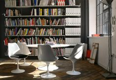 Dieter Rams and Eero Saarinen live harmoniously in this graphic design office with large books and folders stored next to the meeting tableCourtesy of NB Studio