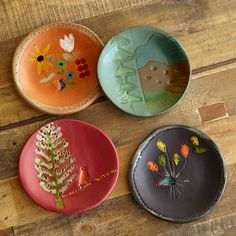 "SUNDANCE MOUNTAIN PLATES, SET OF 4�--�California artist Lisa Neimeth captures the essence of Sundance in an heirloom-worthy, entirely handmade plate set. Tied with twine, a keepsake box handmade in wood and topped with a found stone knob (different on every box) holds four plates, each a different color with a design inspired by an aspect of Sundance. The 5"" dia. size makes them perfect for salads, desserts, fruits, cheeses, hors d�oeuvres. Hand washing recommended. USA. Exclusive.In my ..."