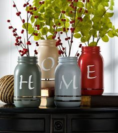 "Use autumnal hues to paint Mason jars, then stencil your word of choice on them. ""Home"" is displayed here, but we also like ""harvest"" or ""autumn."""