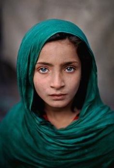 Girl with green shawl, Peshawar, Pakistan, 2002 ~ by Steve McCurry