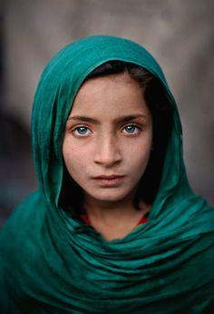 Girl with green shawl, Peshawar, Pakistan, 2002 ~ by Steve McCurry