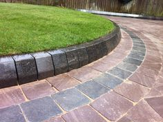Sandstone block paving with limestone kerbs