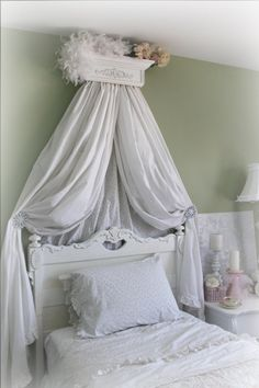 Beautiful White distressed Canopy Bed Crown with Decorative Scroll. $99.95, via Etsy.