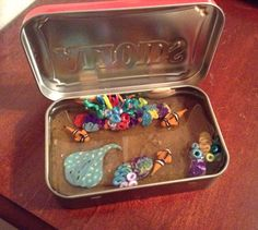 """Handmade """"Ocean aquarium"""" in altoids tin. Coral reef, clown fish, & sting ray. Made with polymer clay and resin."""