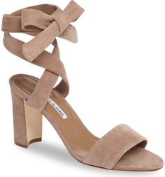 A curvy, wraparound ankle strap adds drama to this supple suede sandal lifted by a sculptural block heel.