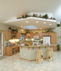 Kitchen With Island And Dropped Ceiling Plant Skylite