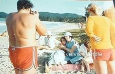 Here is a new a picture not many people have seen before. Of course every fan knows the picture set taken during Elvis' very last vacation in March 1977 in Hawaii with George and Dean Nichopoulos, Larry Geller, Billy and Jo Smith, Joe Esposito and Ginger Alden and her sister Rosemary. This particular shot seems to have been unreleased until now. It is a picture of the photographer of the photo - we suspect it is Joe Esposito. But what it actually shows is how approachable Elvis was and how…