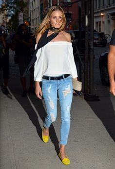 Socialite Olivia Palermo is spotted with a friend out and about in Downtown Manhattan, New York on July 19, 2016. She was rocking a summery off the shoulder top with distressed jeans and yellow flats.