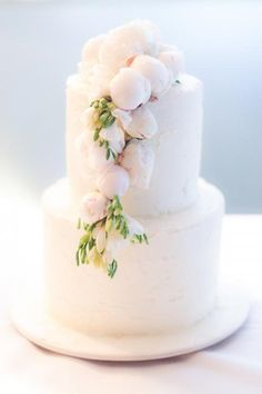 blush pink wedding cake with fresh flowers - peonies?