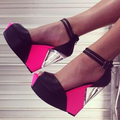 Crystal clear peekaboo in the wedges of these hot pink peeptoe platforms! Very edgy.