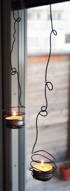 Outdoor Wire Candle Holders - would have to put the candles in tiny jars to keep the wind from blowing them out.