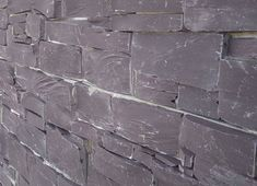 The Penrhyn Z-Stone panel combines real pieces of Bangor Blue slate quarried in Wales with the convenience and cost-saving of a 'ready to fit' panel. Victoria School, External Wall Cladding, Stone Panels, Stone Cladding, Bangor, Cost Saving, Natural Building, Building Materials, Natural Stones