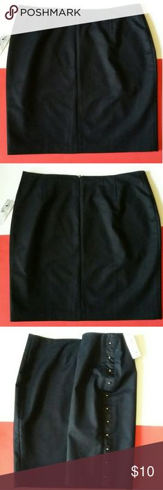 Worthington black lined mini skirt A NWT Classy black lined mini skirt. With a line of gold studs on one side from waist to hem. Waist measures: approx. 17 1/2 inches Hem length: approx. 20 1/2 inches Hip width: approx. 22 1/2 inches Worthington Skirts Mini