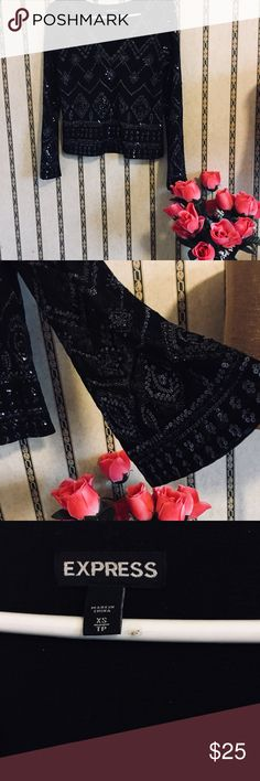 Beautiful black sequenced blouse Express Slightly see-thru blouse. Very nice! Perfect for a dinner party or going out on a Friday night. Sleeves are elegantly belled!! Express Tops Blouses