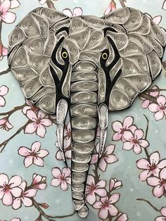This handmade Quilled art is handmade By Me, entirely out of strips of paper. This sits in an 8x10 Frame (frame may vary) An art technique called quilling uses tiny strips of paper to create one of a kind pieces of art. This elephant has a soul when You look into its eyes. Makes a