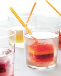 - 8 tablespoons pink lemonade  - 8 tablespoons diluted pomegranate juice  - 4 tablespoon diluted black currant juice  - 8 tablespoons pink lemonade  Prepare all liquids. For each flavor of ice cube, alternately layer the aperitif or lemonade with the fruit juice or nectar in ice cube trays, allowing the liquid to freeze completely before pouring on another layer, about 1 hour. Serve in seltzer.