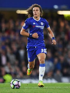 David Luiz Photos Photos - David Luiz of Chelsea in action during the Premier League match between Chelsea and Liverpool at Stamford Bridge on September 16, 2016 in London, England. - Chelsea v Liverpool - Premier League