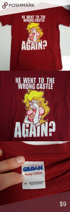He Went To The Wrong Castle Again Mario T-Shirt M This garnet colored T-shirt was purchased at Walmart, for gamer fans or anyone else who appreciates Mario or Princess Toadstool-related references!  A women's Medium, so makes a great sleep/lounging shirt, or theme-park hopping shirt. Worn a handful of times, in great condition! Gildan Tops Tees - Short Sleeve
