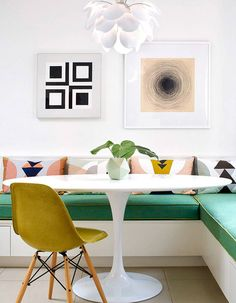 HGTV loves this colorful, modern dining nook with banquette seating and a white tulip table. Modern House Design, Modern Interior Design, Home Design, Design Ideas, Design Trends, Design Projects, Mid-century Interior, Design Inspiration, Interior Colors