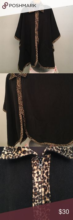 Blanket Poncho with leopard print detail Super warm. Great for watching Football, soccer or any other sport outside during cold weather. Front pockets. Zipper on front. Le Moda Sweaters Shrugs & Ponchos