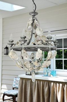 oyster shell chandelier. Darrell and I could collect enough oyster shells to  make this without leaving the yard!