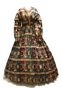 Ca.1860 wrapper with drawstring waist. Has a later alteration that is pulling the front waist out of alignment; frill should be vertical at CF. Listed as cotton, although this type of print was more usually wool. Fenimore Art Museum.