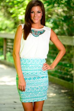 This dress is gorgeous! The bejeweled neckline, fun pattern and the colors... Perfection! This dress is so trendy and is perfect for any occasion!