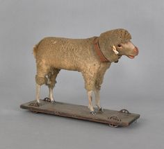 sheep pull toy, early 20th C., 10'' H x 13'' L