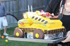Coolest Tonka Truck Cake: For my son's 2nd birthday, we decided to make a big yellow Tonka Truck Cake, as it was his current favourite toy. The sponge is a white choc mud cake,