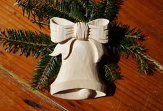 These hand-carved ornaments seem to be pretty popular, so let's continue with a little bell and ribbon! This is another one you can do a lot with for decorating whether it's stained or painted. It would even look nice as bare wood for natural, rustic look on your Christmas tree. In this highly detailed and practical lesson from a classical woodcarver, you see every step so you can develop your own carving abilities. It's one of those lessons you'll want to watch again and again. This lesson…