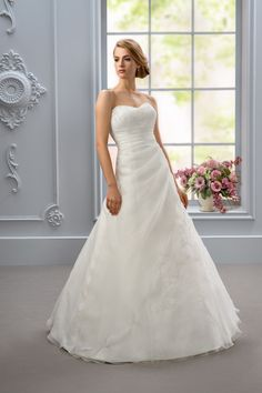 La Sposa - Affezione - A gorgeous fit for every bride. Bodice features lace while a draped organza with a lace up back creates a flattering look. This dress is also available inwhite or ivory.