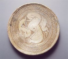 """Bowl with Three Animals, circa 1100-1300 AD. Byzantine. Overall: 1 13/16 x 8 3/4 in. (4.6 x 22.2 cm) """" Bowls very similar to this example have been found in excavations throughout the Byzantine world. Animals associated with the hunt—birds of prey, large cats, deer, hares, and cranes—were common subject matter for Byzantine tableware."""""""