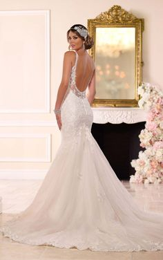 This lavish lace over Royal organza fit-and-flare wedding gown from Stella York glimmers with hand-sewn Diamante beading on its bust, shoulder straps, skirt and low back. The hem has pretty scalloped lace, and the back zips up with ease under Stella crystal buttons.