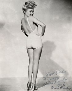 hollywood-starlets-made-the-one-piece-fashionable-with-low-backs-and-straps-you-could-take-off-for-tanning-fabrics-such-as-latex-and-nylon-made-swimsuits-tighter-and-more-form-fitting-throughout-the-30s.jpg (800×1006)