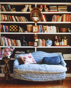 """Book shelf I love - I also like the small littlr """"bar"""" tucked away on one of the shelves"""