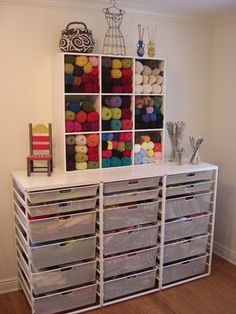 Love the Elfa drawers for fabric storage under a cutting table & a big board.