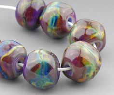 Sari Nuggets. 7 handmade lampwork glass beads by Judith Billig.