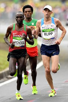 Eliud Kipchoge of Kenya Galen Rupp of the United States and Feyisa Lilesa of…
