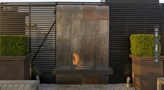 So good - outdoor fireplace/slat wall   CHECK OUT MORE FIREPLACE IDEAS AT DECOPINS.COM   #fireplace #fireplace #hearth #fireplaces #brickfireplace #firepit #fire #firewood #indoorfireplace #outdoorfireplace