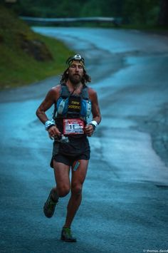 Anton Krupicka, running the road into La Fouly (108k)  at the Ultra Trail Mont Blanc (UTMB)