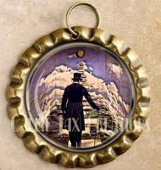 Stairway in Time fantasy art bottle cap pendant. Surreal artwork by Callie Raybourn. Great for purse charms, day planner charms, keychain charms and zipper pulls.