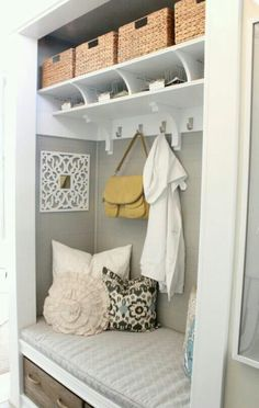 Love the idea of an entry way closet with bench and storage!