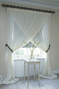Sheer lightness offset by decorative hardware and matching tiebacks