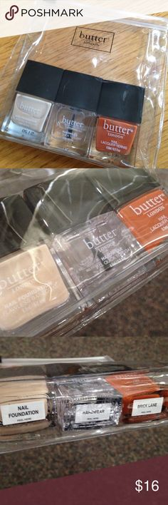 Butter London Nail Polish Trio with Gift Bag Nail polish set by Butter London. Includes nude nail foundation, hardware topcoat, and polish in Brick Lane (an orange/red color). Brand new in package. Clear resealable plastic bag makes it a great gift or a pristine addition to your polish stash! Butter London Makeup